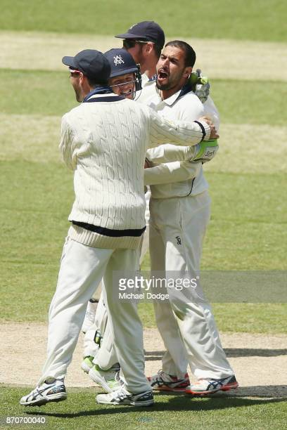 Fawad Ahmed of Victoria celebrates the wicket of Travis Head during day three of the Sheffield Shield match between Victoria and South Australia at...