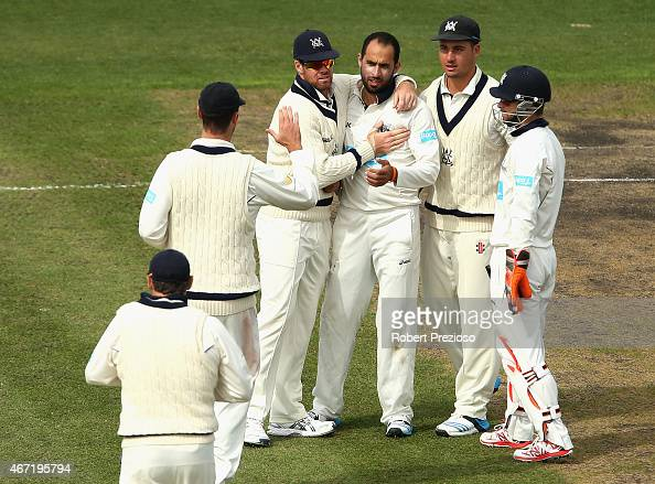 Fawad Ahmed of Victoria celebrates with teammates after taking the wicket of Sam Whiteman of Western Australia during day two of the Sheffield Shield...