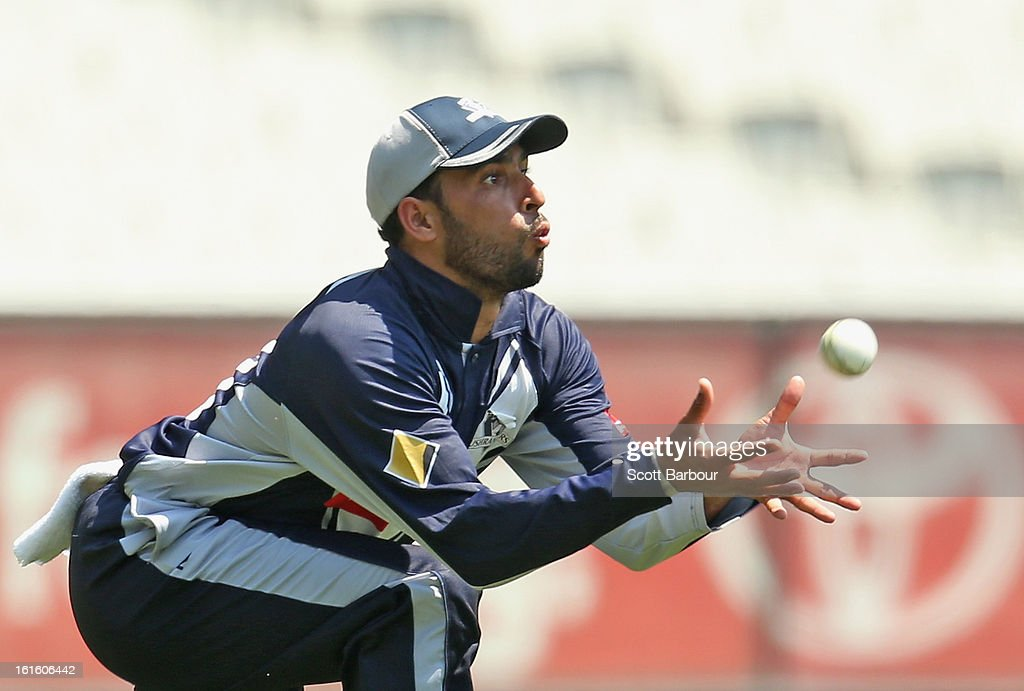 Fawad Ahmed of Victoria takes a catch to dismiss Matthew Coles of the Lions during the international tour match between Victoria and the England Lions at the Melbourne Cricket Ground on February 13, 2013 in Melbourne, Australia.