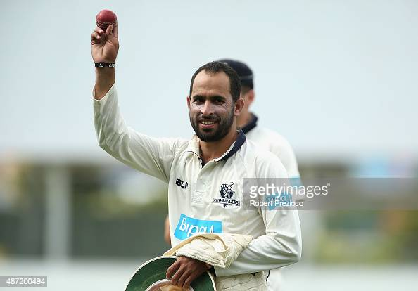 Fawad Ahmed of Victoria walks off holding the ball up high after taking eight wickets during day two of the Sheffield Shield final match between...
