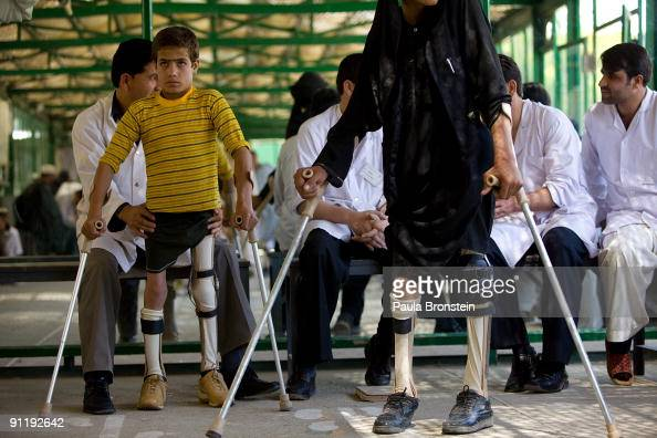 Fawad Rahmani wears his brand new pair of braces fitted from the ICRC Orthopedic clinic on September 25 2009 in Kabul Afghanistan Fawad has had polio...