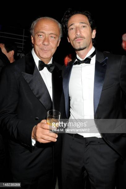Fawaz Gruosi and actor Adrien Brody attend the 2012 amfAR's Cinema Against AIDS after party during the 65th Annual Cannes Film Festival at Hotel Du...