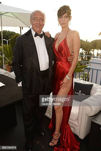 Fawaz Gruosi and Bella Hadid attend a performance by Seal at the de Grisogono showroom Terrace 'Les Oliviers' during the 69th Cannes Film Festival at...