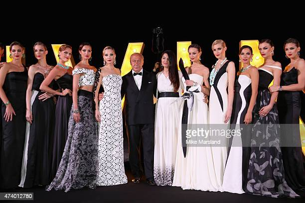 Fawaz Gruosi and Gyunel Rustamova with models at the De Grisogono Divine In Cannes Dinner Party at Hotel du CapEdenRoc on May 19 2015 in Cap...