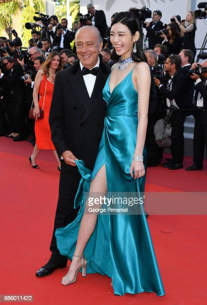 Fawaz Gruosi and Ming Xi attend the '120 Beats Per Minute ' screening during the 70th annual Cannes Film Festival at Palais des Festivals on May 20...