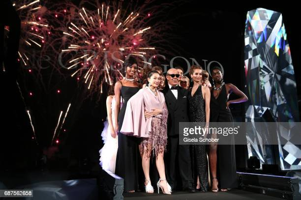Fawaz Gruosi and models during the DeGrisogono 'Love On The Rocks' gala during the 70th annual Cannes Film Festival at Hotel du CapEdenRoc on May 23...