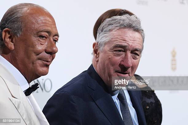 Fawaz Gruosi and Robert De Niro attend the De Grisogono Party at the annual 69th Cannes Film Festival at Hotel du CapEdenRoc on May 17 2016 in Cap...