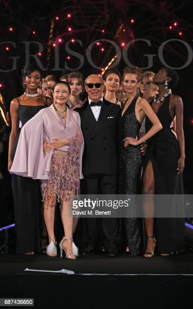 Fawaz Gruosi poses with models at the de Grisogono 'Love On The Rocks' party during the 70th annual Cannes Film Festival at Hotel du CapEdenRoc on...