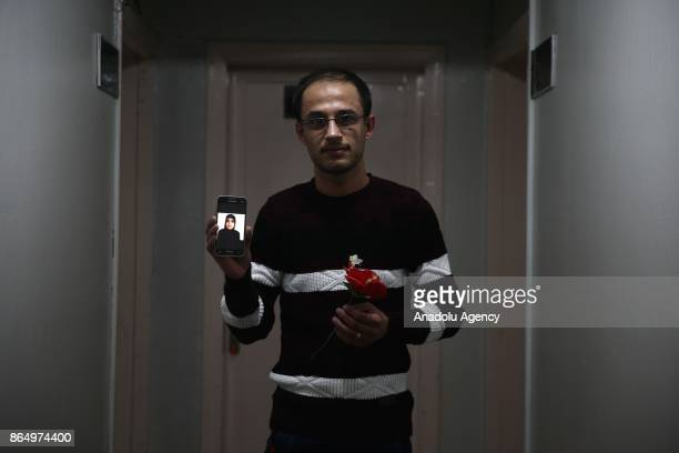 Fayat alDarvish shows a photo of his fiancee from his mobile phone in Gaziantep Turkey on October 20 2017 Eight Syrian teenagers forced to be...