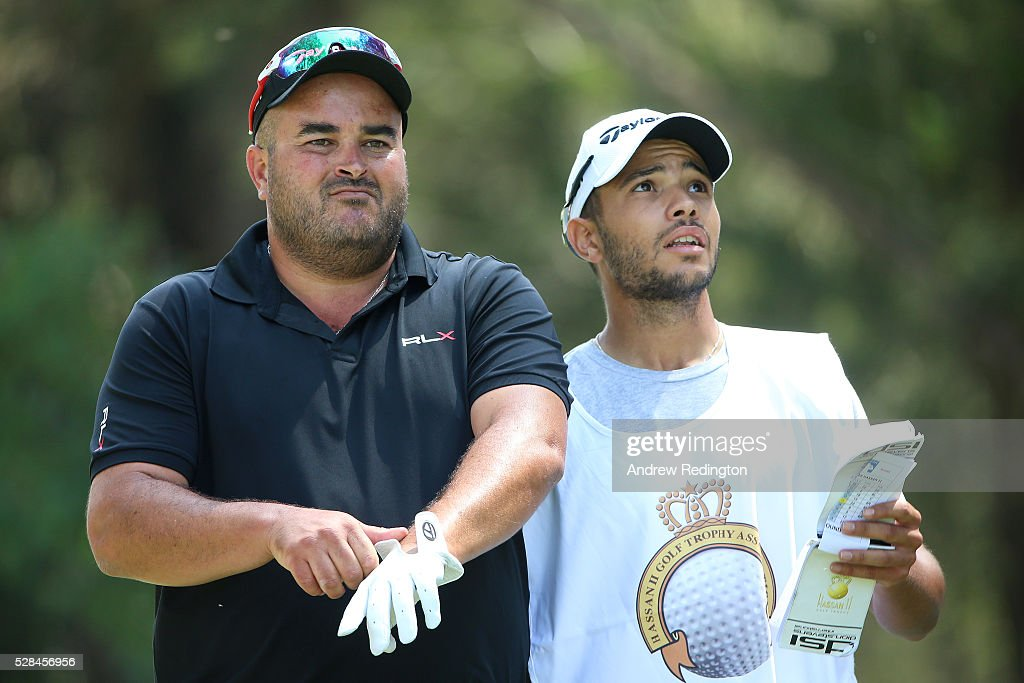 Faycal Serghini of Morocco speaks with his caddie before hitting his tee shot on the 2nd during the first round of the Trophee Hassan II at Royal Golf Dar Es Salam on May 5, 2016 in Rabat, Morocco.
