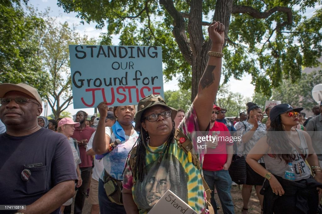 Faye Dixon, of Washington D.C., pumps her fist during a 'Justice for Trayvon' rally in Washington, D.C., Saturday, July 20, 2013. 'Like my son says, 'It's not okay,'' she said. 'And people need to know it's not okay. When you get tired of being tired you've got to stand up and be apart of something bigger than yourself. Every time they look at us they put us on trial.'