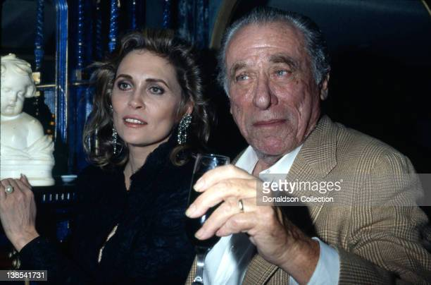 Faye Dunaway and Charles Bukowski attend an event in November 1987 in Los Angeles California