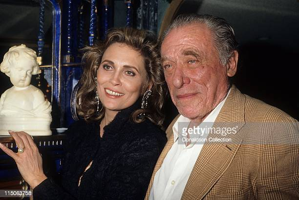 Faye Dunaway and Charles Bukowski pose for a portrait November 1987 in Los Angeles California