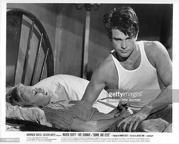 Faye Dunaway laying in bed next to Warren Beatty in a scene from the film 'Bonnie and Clyde' 1967