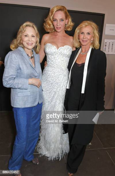 Faye Dunaway Uma Thurman and Trudie Styler pose backstage at the Fashion for Relief event during the 70th annual Cannes Film Festival at Aeroport...