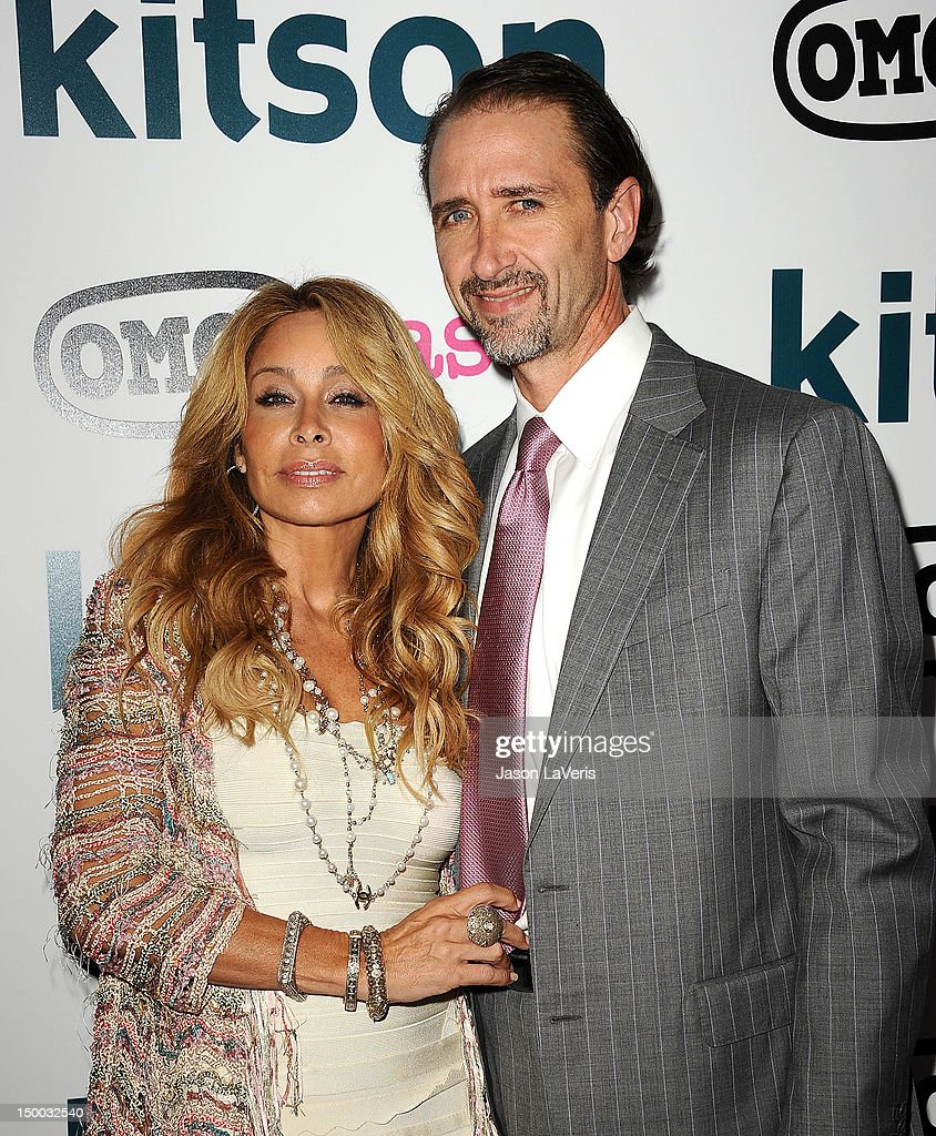 Faye Resnick and Everett Jack, Jr. attend the launch party for 'OMG Cases' at Kitson on Roberston on August 8, 2012 in Beverly Hills, California.