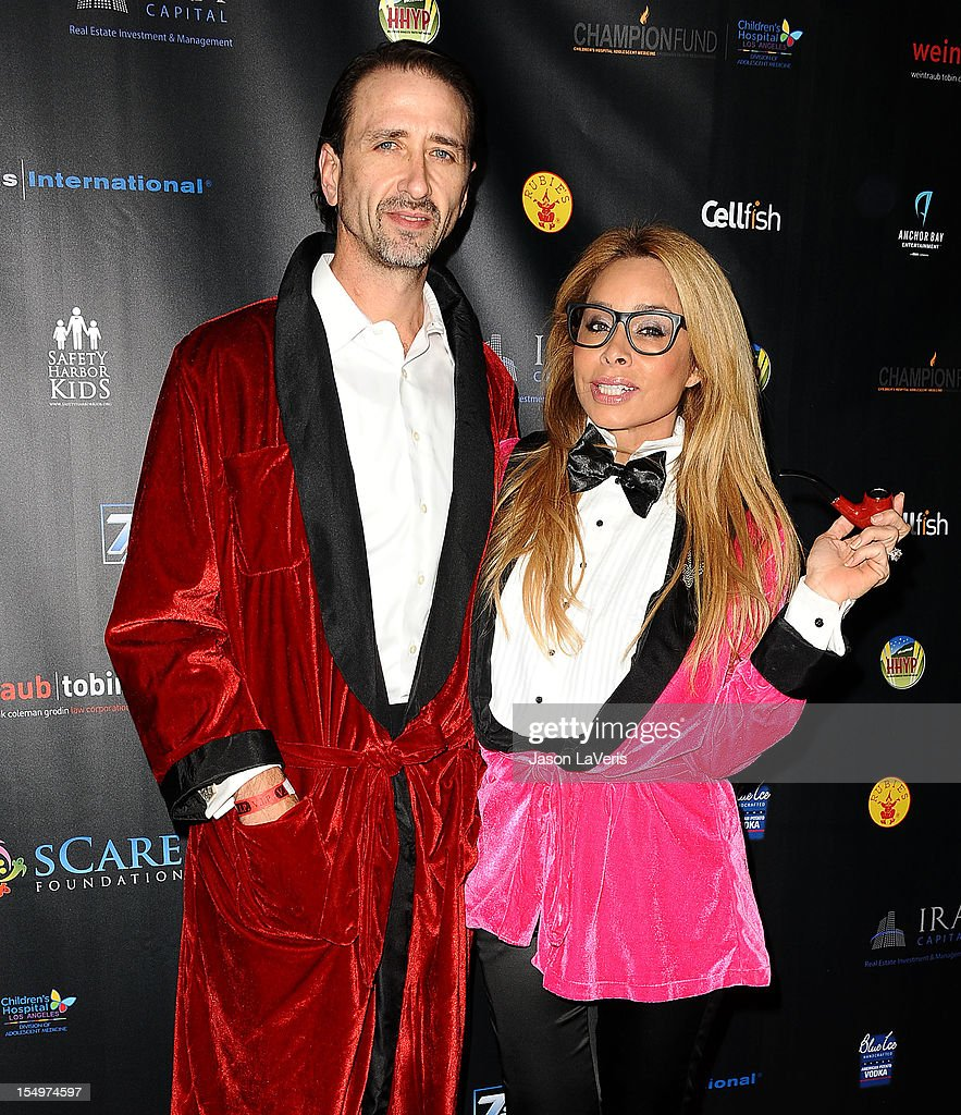 Faye Resnick (R) and Everett Jack Jr. attend the sCare Foundation's 2nd annual Halloween benefit event at The Conga Room at L.A. Live on October 28, 2012 in Los Angeles, California.