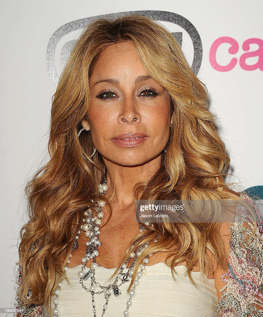 <a gi-track='captionPersonalityLinkClicked' href=/galleries/search?phrase=Faye+Resnick&family=editorial&specificpeople=2606348 ng-click='$event.stopPropagation()'>Faye Resnick</a> attends the launch party for 'OMG Cases' at Kitson on Roberston on August 8, 2012 in Beverly Hills, California.