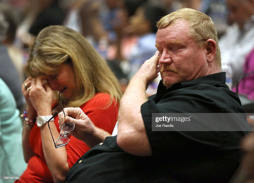 Faye Wade (L) and Keith Wade are overcome with emotion as they remember their son during a ceremony to remember and honor those who have died in service to the nation and the families they have left behind at U.S. Southern Command headquarters on May 20, 2013 in Doral, Florida. U.S. Marine Gen. John Kelly presided over the ceremony where the families of 57 fallen service members from South Florida were invited to attend.