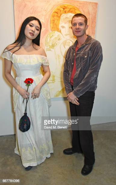 Faye Wei Wei and Dominic Jones attend a private view of artist Faye Wei Wei's exhibition 'Anemones And Lovers' at Cob Gallery on April 12 2017 in...