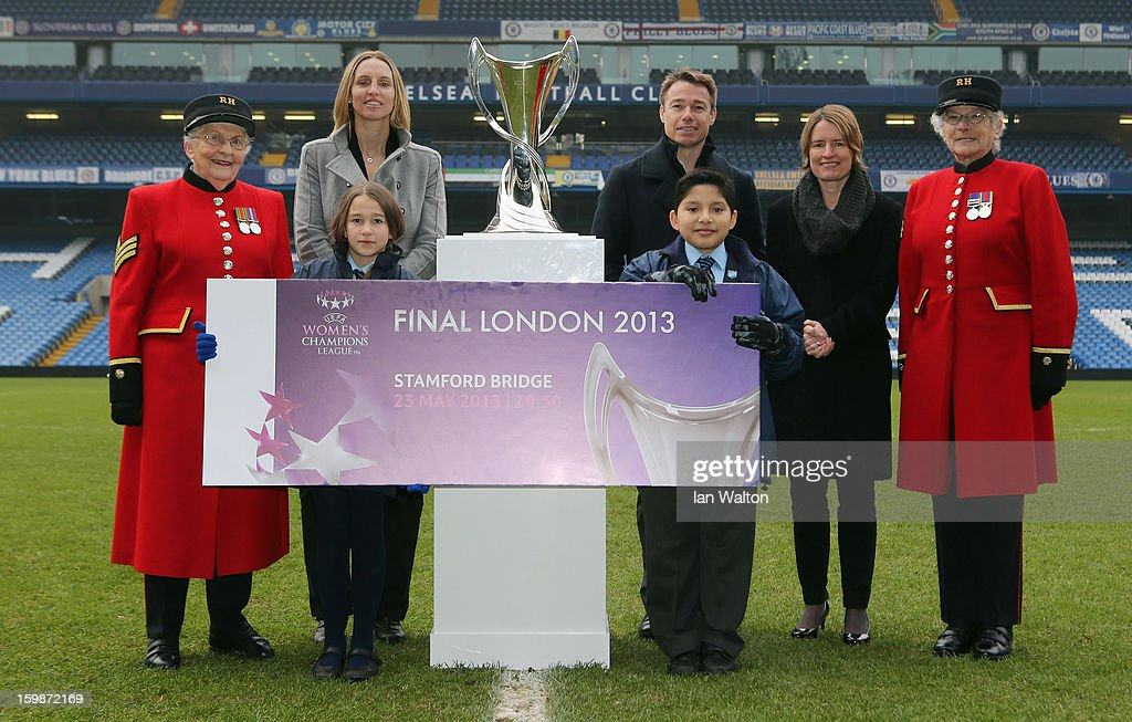 Faye White (2nd L) and Graeme le Saux (C) and Kelly Simmons, Director of The National Game and Women's Football, The Football Association (2ndR)pose with children and Chelsea Pensioners during the ticket launch for the UEFA Women's Champions League Final at Stamford Bridge on January 22, 2013 in London, England.