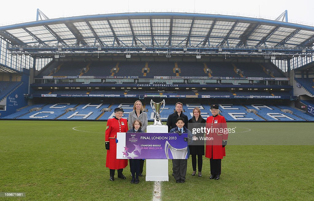 Faye White and Graeme le Saux, Kelly Simmons, Director of The National Game and Women's Football, The Football Association pose with children and Chelsea Pensioners during the ticket launch for the UEFA Women's Champions League Final at Stamford Bridge on January 22, 2013 in London, England.