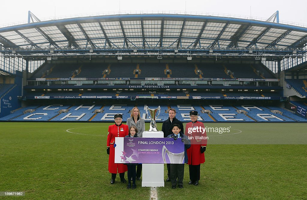 Faye White and Graeme le Saux pose with children and Chelsea Pensioners during the ticket launch for the UEFA Women's Champions League Final at Stamford Bridge on January 22, 2013 in London, England.