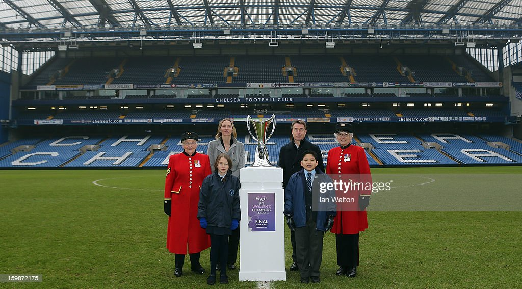 Faye White (2nd L) and Graeme le Saux pose with children and Chelsea Pensioners during the ticket launch for the UEFA Women's Champions League Final at Stamford Bridge on January 22, 2013 in London, England.