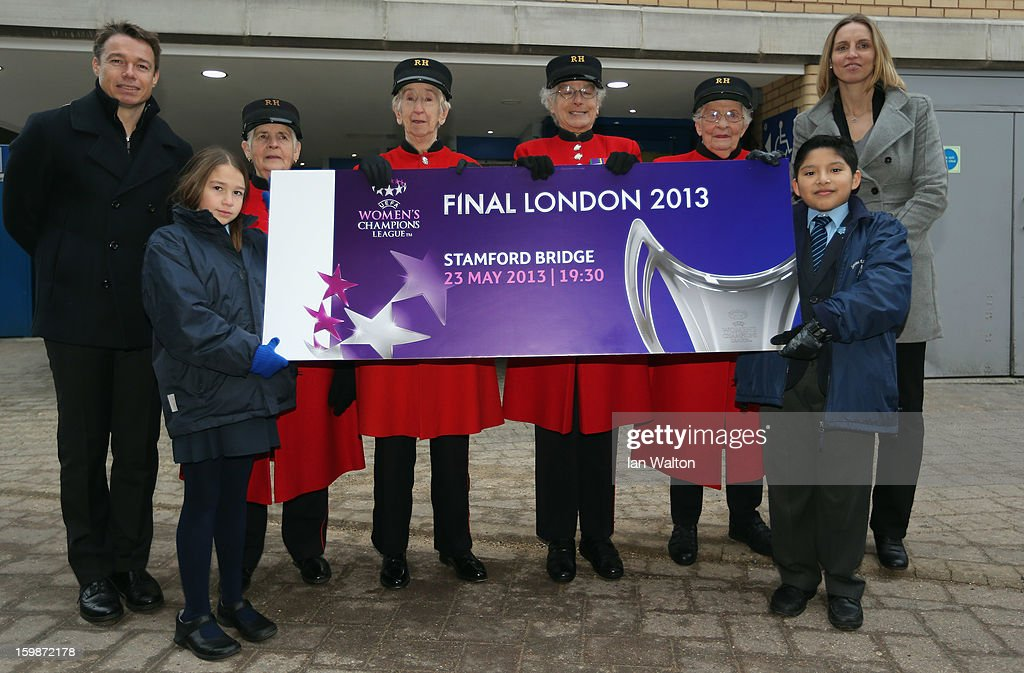Faye White (R) and Graeme le Saux pose with children and Chelsea Pensioners during the ticket launch for the UEFA Women's Champions League Final at Stamford Bridge on January 22, 2013 in London, England.
