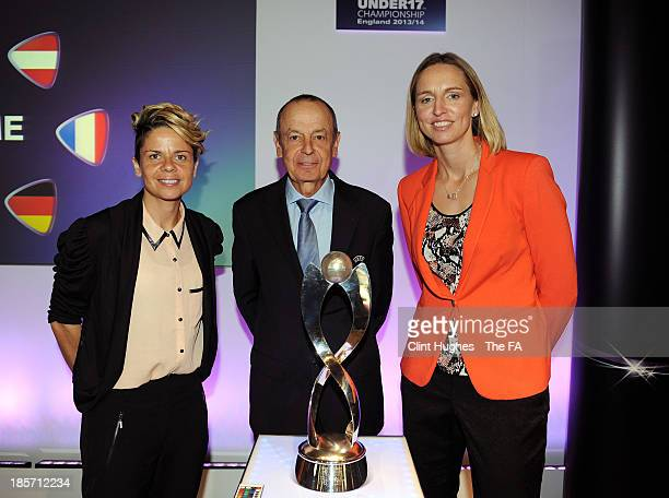 Faye White and Sue Smith and Mikael Salzer UEFA Head of Women's and Futsal Competitions pose together with the European Women's Under 17 trophy...