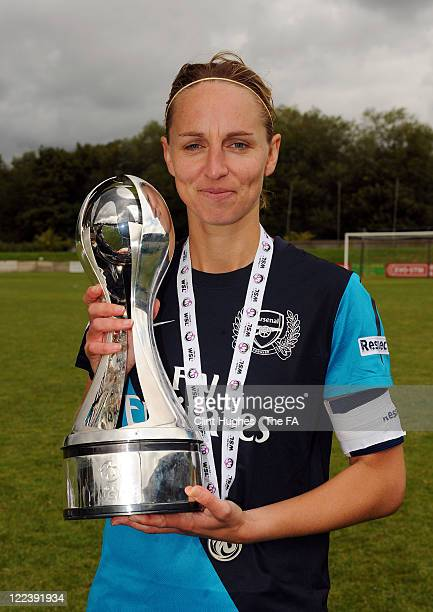 Faye White captain of Arsenal celebrates as she lifts the WSL trophy during the FA WSL match between Liverpool Ladies FC and Arsenal Ladies FC at the...