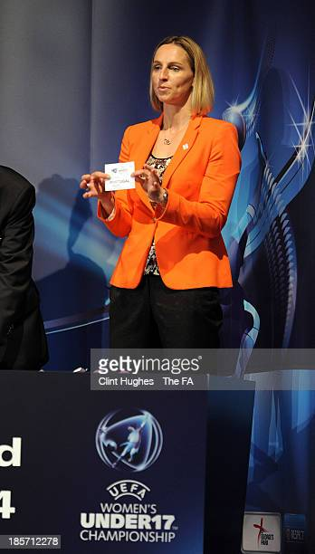 Faye White draws a team from the pot during the UEFA European Women's Under 17 Championship Draw at Burton Town Hall on October 24 2013 in Burton...