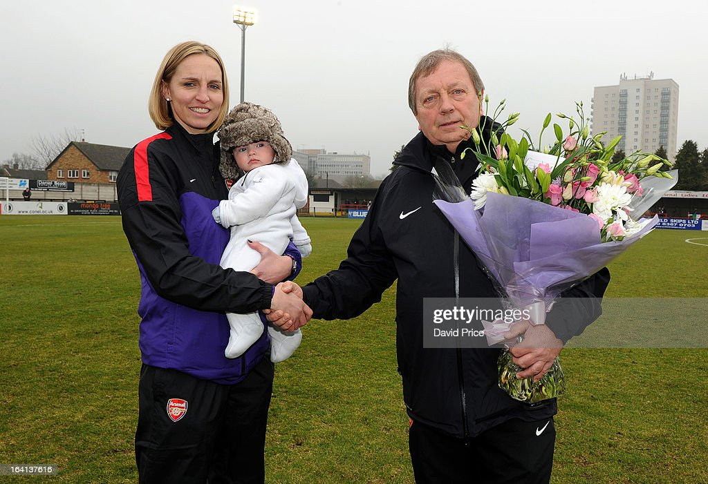 Faye White (L) of Arsenal Ladies FC is presented with flowers by General Manager Vic Ackers of Arsenal Ladies FC, having announced that she will retire from football following a 15 year Arsenal career, during the Women's Champions League Quarter Final match between Arsenal Ladies FC and ASD Torres CF at Meadow Park on March 20, 2013 in Borehamwood, United Kingdom.