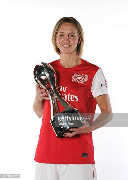 Faye White of Arsenal Ladies FC with the trophies won this season during a Photo Shoot at London Colney on October 04 2011 in St Albans England