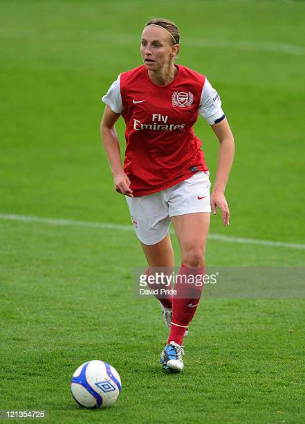 Faye White of Arsenal runs with the ball during the FA Women's Super League match between Arsenal Ladies FC and Everton Ladies FC at Meadow Park on...