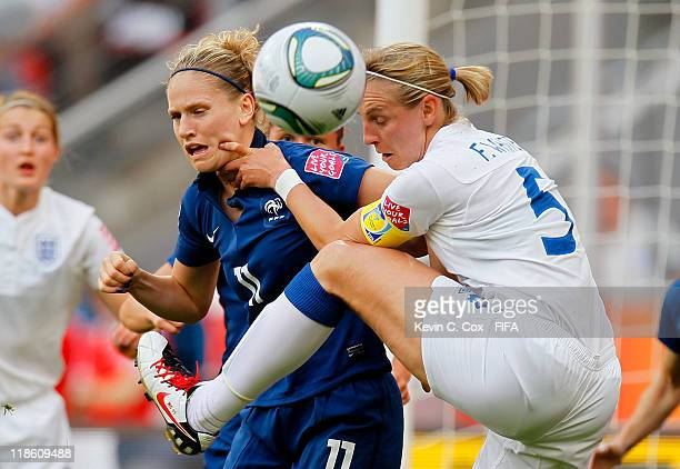 Faye White of England challenges Laure Lepailleur of France during the FIFA Women's World Cup 2011 Quarter Final match between England and France at...