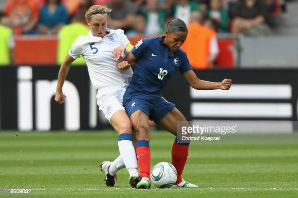 Faye White of England challenges MarieLaure Delie of France during the FIFA Women's World Cup 2011 Quarter Final match between England and France at...