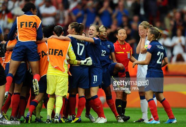 Faye White of England looks dejected next to the celebration of players of France after missing the last penalty and loosing the FIFA Women's World...