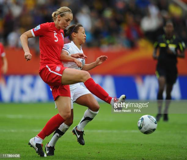 Faye White of England tackles Sarah Gregorius of New Zealand during the FIFA Women's World Cup 2011 Group B match between New Zealand and England at...
