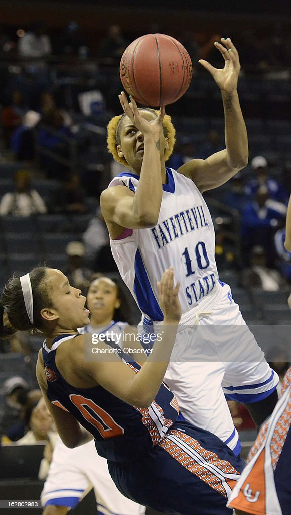 Fayetteville State's Kristen Hazen, right, drives the ball against Lincoln University's Britteny Waters in CIAA Tournament action on Wednesday, February 27, 2013, at Time Warner Cable Arena in Charlotte, North Carolina. Fayetteville State advanced to the semifinals, 60-46.
