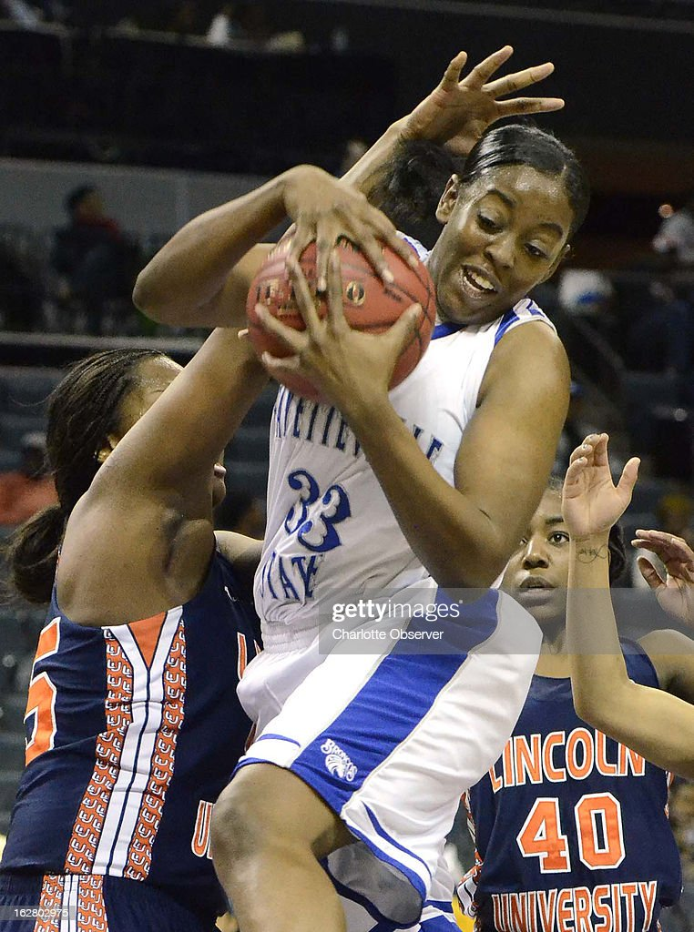 Fayetteville State's Tierra Coleman (33) gains control of the ball against Lincoln University's Mfon Ekanem, left, in CIAA Tournament action on Wednesday, February 27, 2013, at Time Warner Cable Arena in Charlotte, North Carolina. Fayetteville State advanced to the semifinals, 60-46.