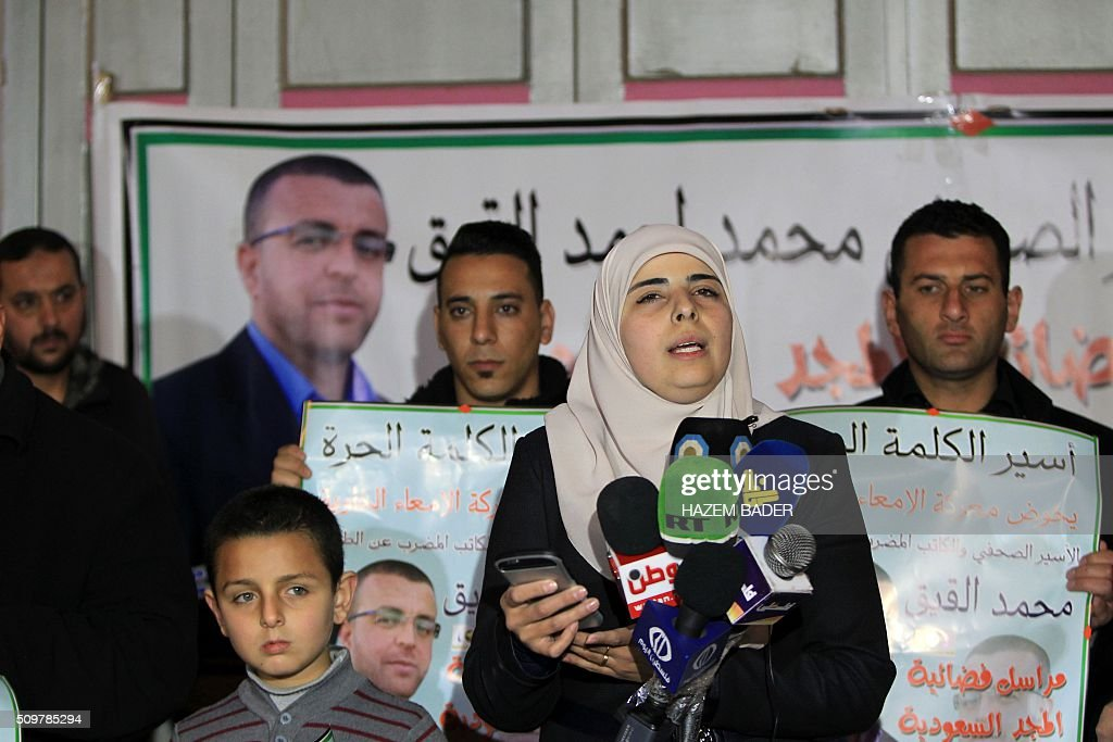 Fayha Shalash, the wife of hunger striking Palestinian prisoner Mohammed al-Qiq, speaks during a press conference in the West Bank town of Hebron on February 12, 2016. Qiq, 33, a correspondent for Saudi Arabia's Almajd TV network, was arrested on November 21 at his home in the West Bank city of Ramallah and placed under administrative detention, an Israeli procedure allowing indefinite imprisonment without trial. / AFP / HAZEM BADER