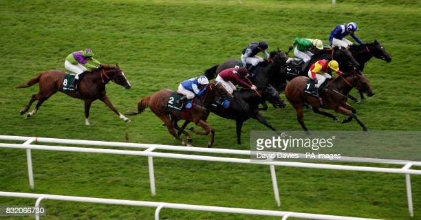 Fayr Jag ridden by jockey David Allan surges ahead to win the Stan James Hackwood Stakes at Newbury Racecourse