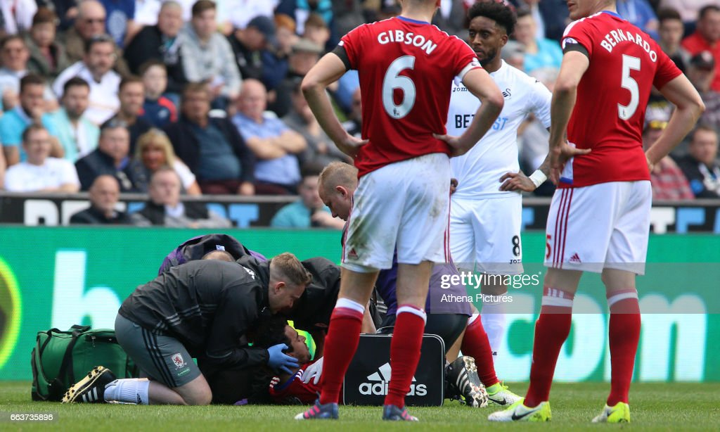 Fábio of Middlesbrough lies on the floor after becoming concust during the Premier League match between Swansea City and Middlesbrough at The Liberty Stadium on April 2, 2017 in Swansea, Wales.