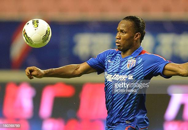 FblAsiaCHNDrogbaFOCUS by Cameron Wilson This photo taken on August 4 2012 shows Didier Drogba controlling the ball as he plays for Shanghai Shenhua...