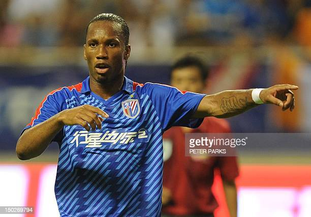 FblAsiaCHNDrogbaFOCUS by Cameron Wilson This photo taken on August 4 2012 shows Didier Drogba gesturing as he plays for Shanghai Shenhua FC in their...