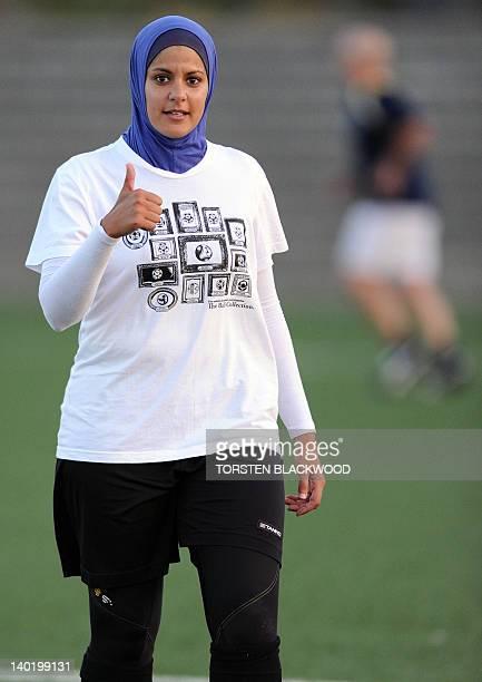 STORY 'FblAUSAsiaFIFAreligionIslamwomenFEATURE' by Amy Coopes AustralianEgyptian soccer player Assmaah Helal wears a Muslim head cover or hijab...