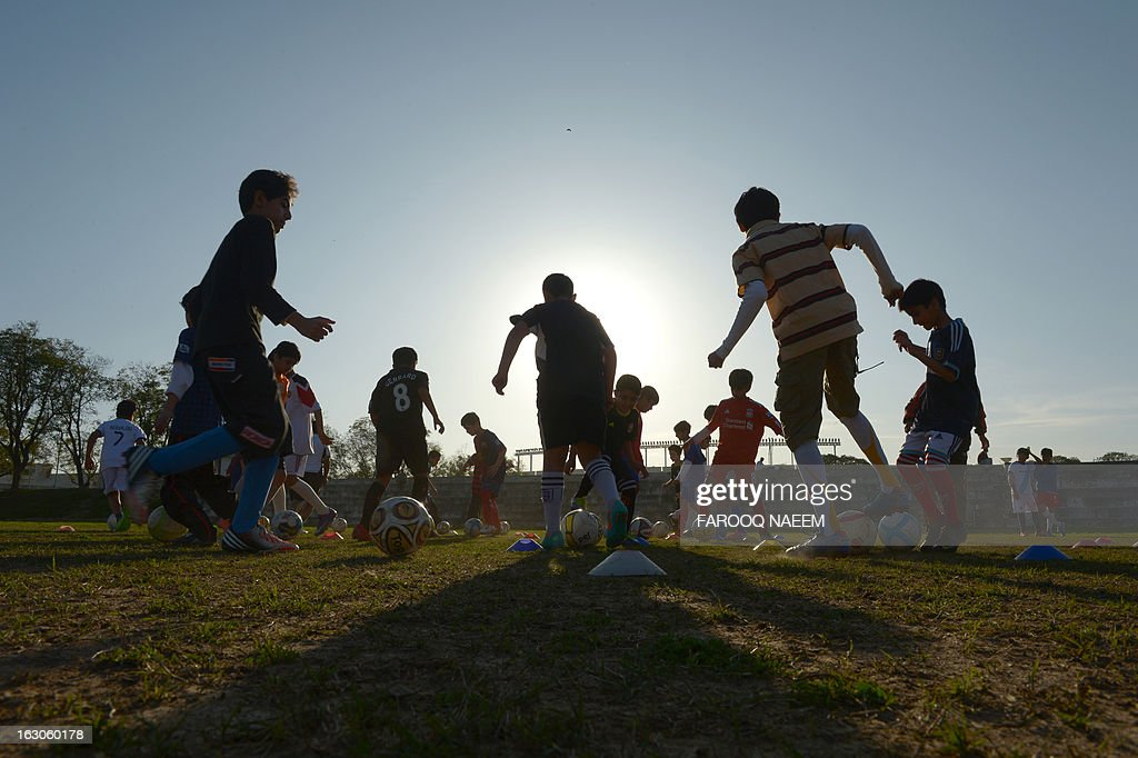 Fbl-PAK-AFC,FOCUS by Damon Wake In this photograph taken on March 2, 2013, Pakistani children of the Islamabad Football Academy take part in a practice session at a Sports Complex in Islamabad. Pakistan is planning a major new football competition modelled on cricket's hugely successful Indian Premier League in a bid to revitalise a sport which has long stagnated. The Pakistan Football Federation (PFF) is in talks with potential sponsors for the proposed league, which would feature six city-based teams playing each other in Lahore, officials told AFP. AFP PHOTO/Farooq NAEEM