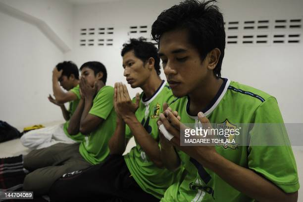 STORY 'FblThailandreligionunrestsports' by Carol Isoux This picture taken on May 6 2012 shows Muslim players of the Pattani FC football club praying...