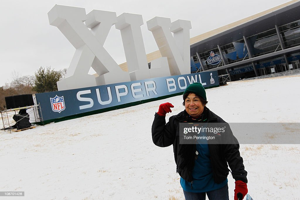 Fe Gilles of Melbourne, Australia reacts to the snow and ice while visiting an NFL Super Bowl XLV display February 1, 2011 in Dallas, Texas. A major ice storm hit the Dallas/Fort Worth area overnight days before Super Bowl XLV is to be held in Arlington, Texas.